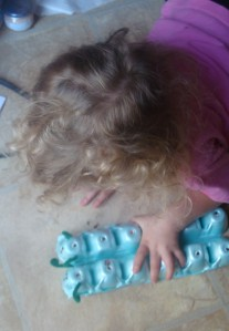 Playing with her caterpillars