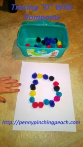 "Tracing ""D"" With Pompoms"